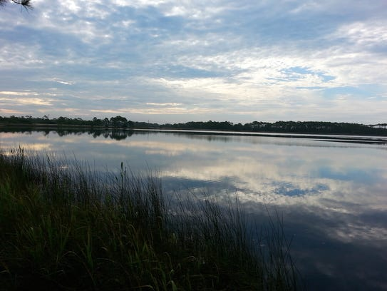 Clouds are mirrored on the surface of Western Lake