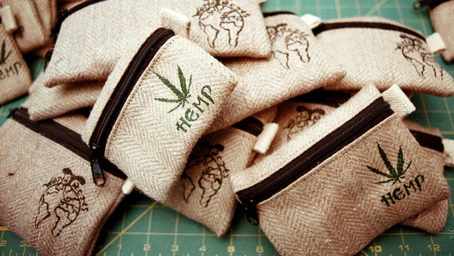 Hemp pouches made by World Roots are piled together in Williams, Ore. All the hemp for these products was grown overseas.