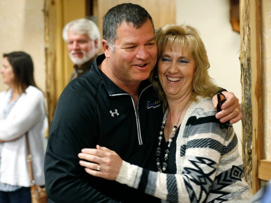 At a surprise retirement party in May 2017, Willard Superintendent Kent Medlin hugs Sharon Petty.