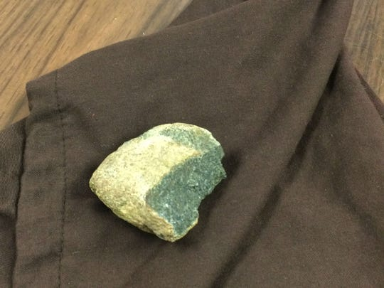 How did this rock apparently fall from the sky and hit the garage of Daniel and Kathryn Seip near DeWitt?