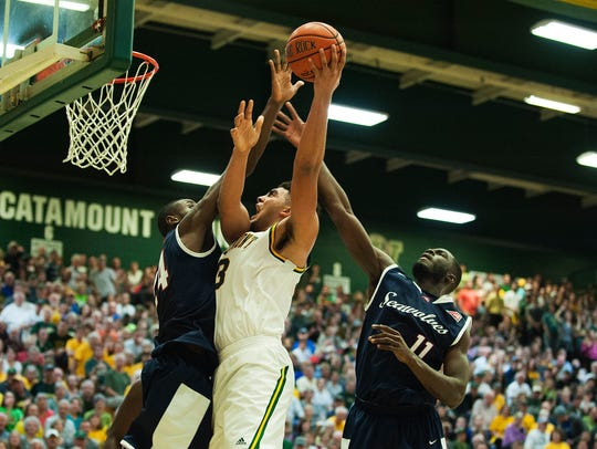 Catamounts forward Anthony Lamb (3) leaps for a lay