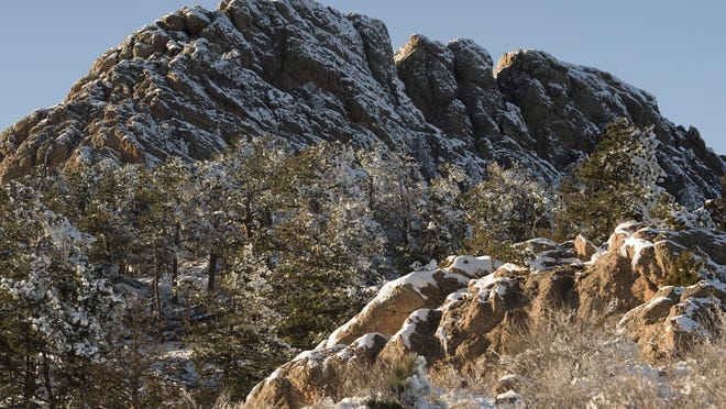 Horsetooth Rock is blanketed with snow earlier this winter. Take a hike through the snow to the iconic landmark.