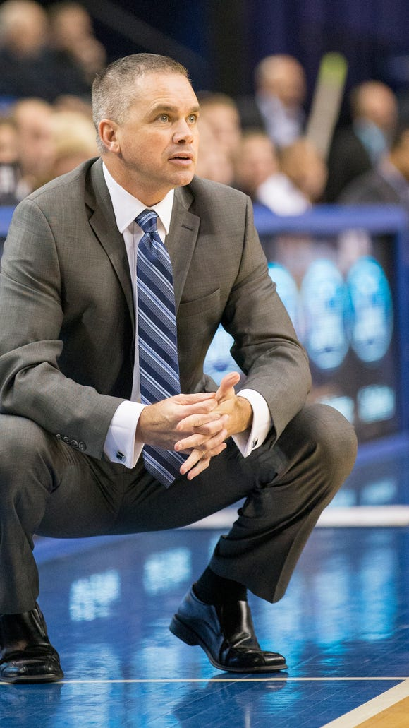 Butler interim coach Chris  Holtmann observes the action during the Bulldogs' 77-54 victory at Indiana State on Dec. 3, 2014.
