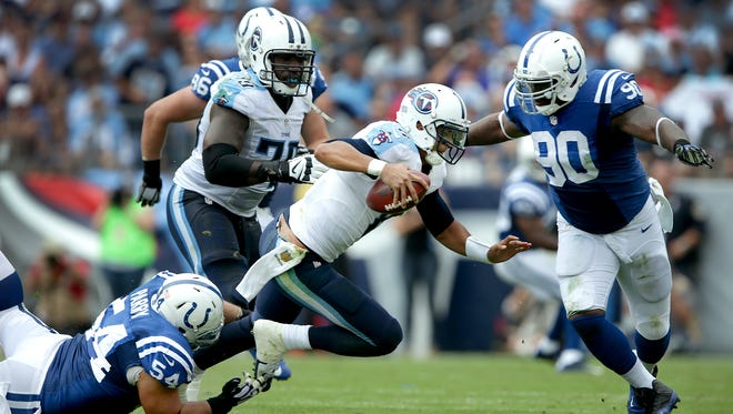 Tennessee Titans quarterback Marcus Mariota (8) is tackled by Indianapolis Colts nose tackle David Parry (54),left, and defensive end Kendall Langford (90)in the first half of their game Sunday, September 27, 2015 at Nissan Stadium in Nashville TN.