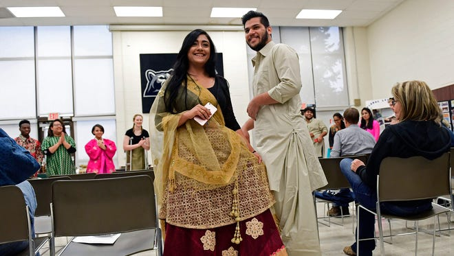 """Sophomore Aashka Patel, left, poses with to sophomore Hamza Khan during Unity Day at Penn State York on Thursday. Patel's dress is from India while Khan's clothes are from Pakistan. The 20th annual event is an opportunity to """"educate, understand and appreciate the differences among us and embrace the many similarities,"""" according to a news release.It featured everything from a fashion show to different food samples."""