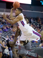 "Evansville's Duane ""Boo"" Gibson draws the blocking foul on Austin Peay's Tre' Ivory (1) during the first half at the Ford Center Saturday afternoon. The Purple Aces beat the Governors 78-74 in overtime to improve to 9-2 on the season."