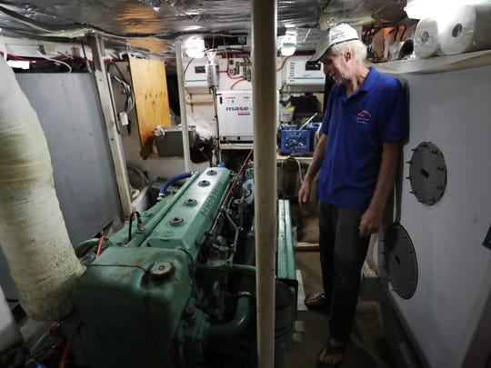 Dave Cooper inspects the diesel engine during a walk-through