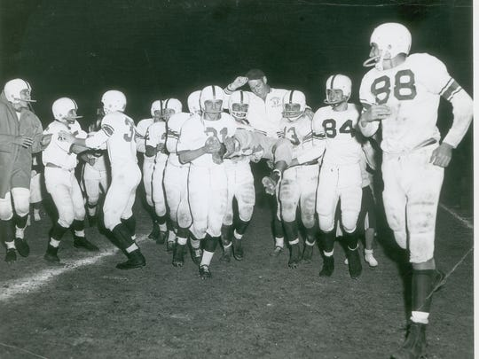 1958 Manual football team from left at No. 31 — Dave