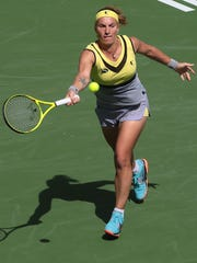 Svetlana Kuznetsova, of Russia, returns the ball to  Anastasia Pavlyuchenkova, of Russia in the BNP Paribas Open women's quarter finals Wednesday, March 15, 2017 in Indian Wells, CA.