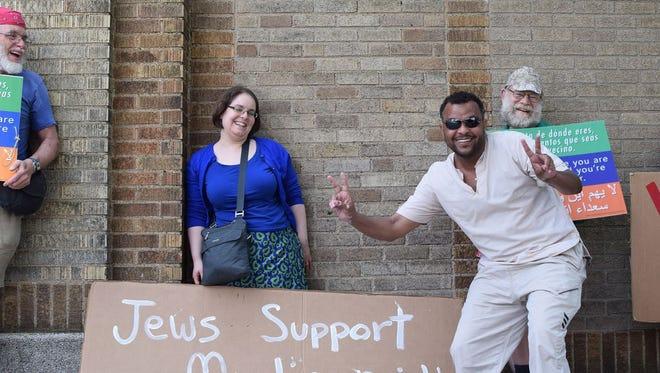 Members of Kol Tzedek Synagogue rally in support of Muslims outside the Masjid Al-Jamia mosque in West Philadelphia.