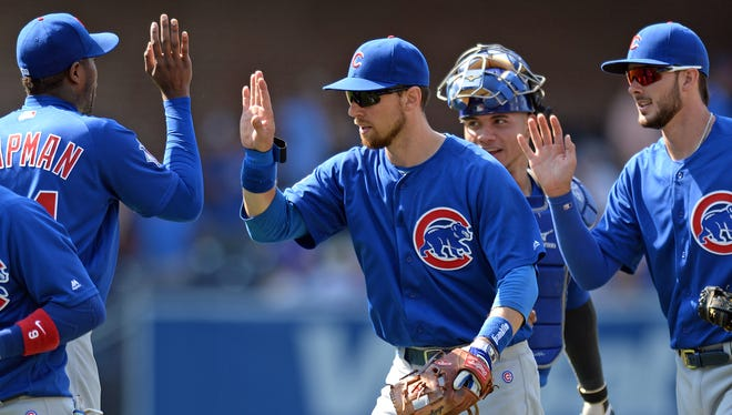 The Chicago Cubs players celebrate after defeating the San Diego Padres 6-3 at Petco Park.