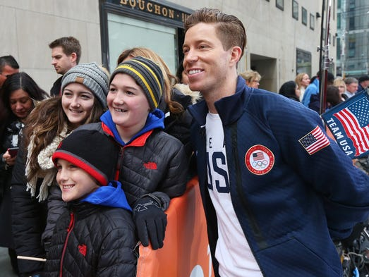 Olympic snowboarder Shaun White poses for a photo with