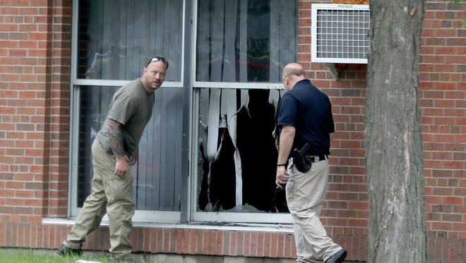 Law enforcement officials in August of 2017 investigate an explosion at the Dar Al-Farooq Islamic Center in Bloomington.