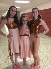 Color guard Varsity Castle Color Guard members Elise Renschler, Hayley Hazelip and Natasha Williams pause for a photo at the WGI Regionals at Warren Central in Indianapolis. Following their performance, they moved on to finals the next day.
