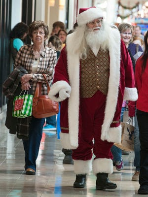 Santa Claus walks though West Town Mall  with Black Friday shoppers.