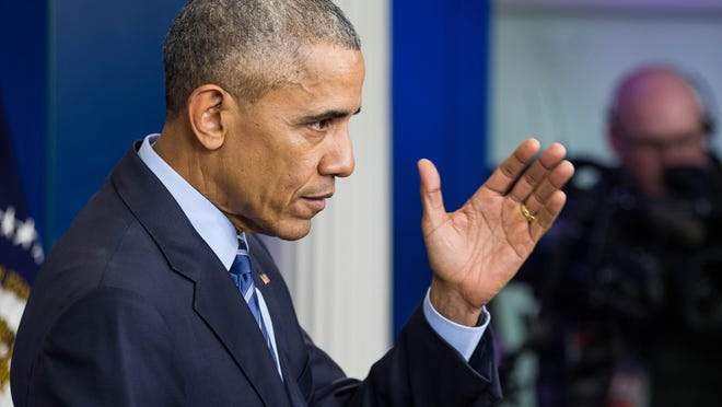 President Barack Obama commuted the sentences of more prisoners Thursday, including two men from Wisconsin.