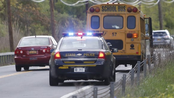 A school bus and a New York State Trooper.