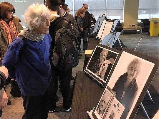 An attendee looks at the display at the International Holocaust Remembrance Day observance at the Holocaust Museum & Center for Tolerance and Education at Rockland Community College.