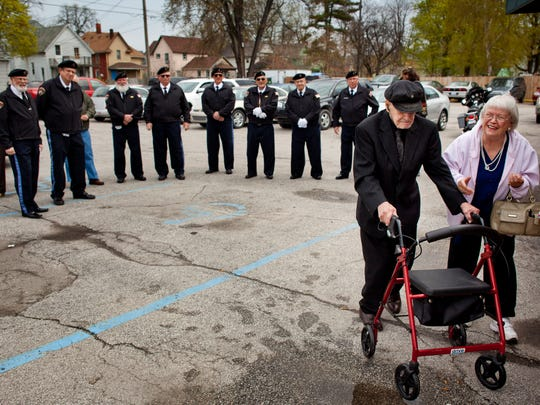 Carl Ladensack, a World War II veteran, walks next to his sister Anna Dandron, of Marine City, after being greeted by the Veteran Honor Guard Alliance during his surprise 99th birthday party Wednesday, May 6, 2015 at Tom Manis restaurant in Port Huron.