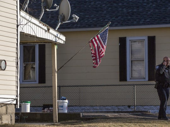 Members of the Port Huron Police Department work to dismantle a meth lab Tuesday, at 1040 Chestnut St. in Port Huron.