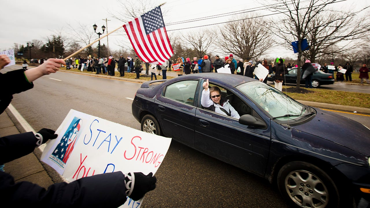 """Hundreds gathered to protest against Trump and to support Rawd Saleh, a Mason resident who was the subject of a pamphlet titled """"Neighborhood Terrorism Warning,"""" that was distributed in her neighborhood, displaying her photo and address."""