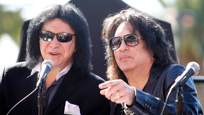 Musicians Gene Simmons (left) and Paul Stanley of Kiss attend a news conference to announce their part-ownership of Arena Football League team the Los Angeles Kiss in Anaheim, Calif., on March 10, 2014.
