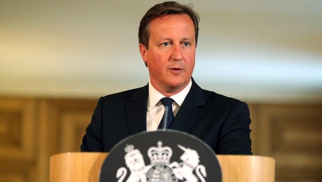 Britain's Prime Minister David Cameron speaks at a news conference at 10 Downing Street in central London on Aug. 29, 2014.