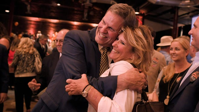Republican Tennessee Governor candidate Bill Lee hugs Wendy Carter at his primary election night party at the Factory in Franklin, Tenn. on August 2, 2018.