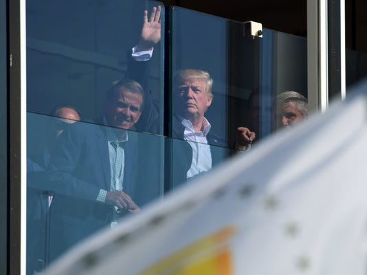 President Donald Trump watches the Presidents Cup golf tournament in Jersey City, N.J., Sunday, Oct. 1, 2017. The President of the United States is the Honorary Presidents Cup Chairman. (AP Photo/Susan Walsh)
