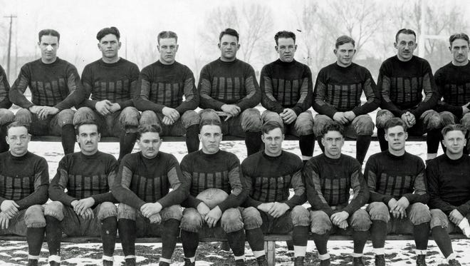 Coach Harry Hughes, far right, took his 1925 Colorado Agricultural College football team to Hawaii. The trip took 13 days.