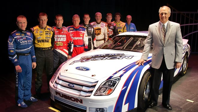 Dan Davis, director of Ford Racing Technology, right, stands with NASCAR drivers in this 2005 file photo.