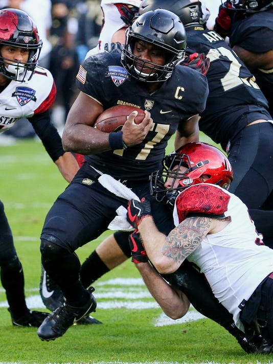 Army quarterback Ahmad Bradshaw (17) stopped by San Diego State safety Parker Baldwin during the first half of the Armed Forces Bowl in an NCAA college football game in Fort Worth, Texas, S (Steve Nurenberg/Star-Telegram via AP)