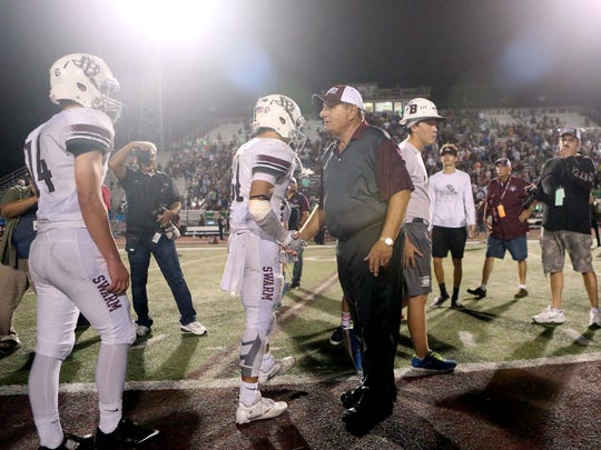 Calallen head coach Phil Danaher shakes hands with Flour Bluff players as he wins his 427th career game and the district 30-5A championship on Thursday Nov. 3, 2016, at Wildcat Stadium in Corpus Christi.