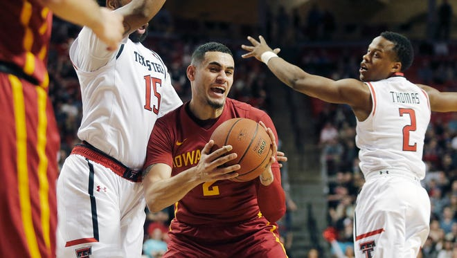 Iowa State forward Abdel Nader looks for an open teammate as he is defended by Texas Tech forward Aaron Ross (15) and Devon Thomas during the first half of an NCAA college basketball game, Wednesday, Feb. 10, 2016, in Lubbock, Texas.