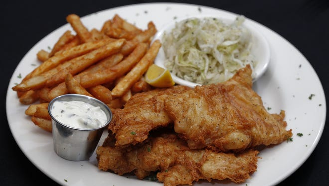 Beer-battered cod dinner with sweet and sour coleslaw, fries and homemade tartar sauce.