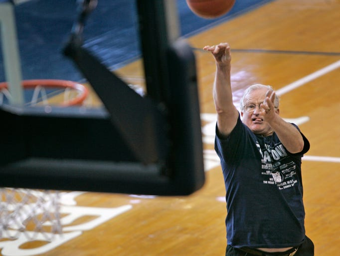 Bobby Plump shoots from the same spot, Thursday, April 2, 2010, where he made his famous final game-winning shot for the Milan High School state championship in 1954 at Hinkle Fieldhouse.  (Kelly Wilkinson / The Star)