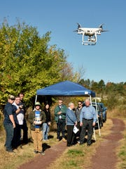Scientists demonstrate a drone used by the Meadowlands
