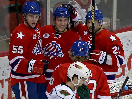 After scoring his team's first goal in first period action, Rochester Americans' #26 Johan Larsson, center, celebrated with teammates #55 Rasmus Ristolainen, left, and #21 Kevin Porter, right, against the Iowa Wild in hockey game at Wells Fargo Arena in Des Moines on Thursday night Feb. 27, 2014.