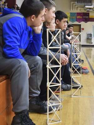 Luxemburg-Casco Middle School eighth graders watch with their towers while classmates compete in the Tower Challenge.