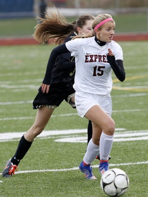 Gabby Seymour of Elmira brings the ball up the field in front of Corning's Liz Casey on Wednesday during the Express' 2-0 victory in a Section 4 Class AA semifinal at Ernie Davis Academy.