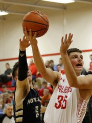 Scott Woodring of Waverly puts up a shot as Elmira