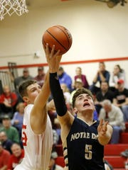 Gary Raupers of Elmira Notre Dame goes up for a layup
