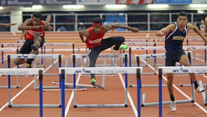 David Adams of Beacon takes first and Philippe Louis Juste of North Rockland comes in second the Boys 55 Meter Hurdles during the Section 1 State Indoor Track and Field Qualifier at the Armory in Manhattan Feb. 21, 2016.