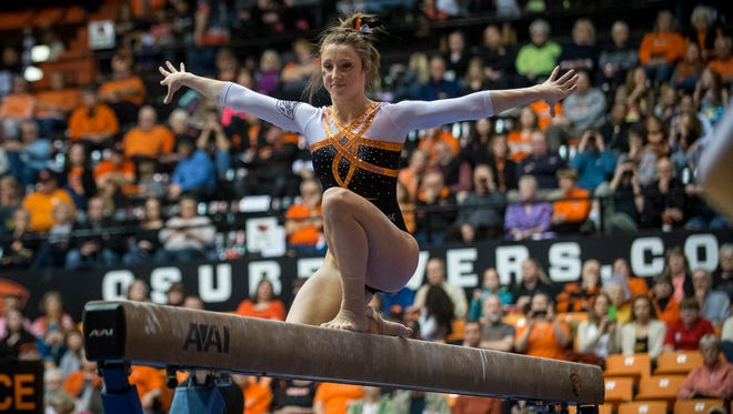 Kaytianna McMillan, competing on beam at a recent meet, was named All-American on uneven bars this season.
