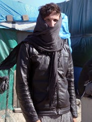 Ali Lalmamad, a former taxi driver who fled Afghanistan