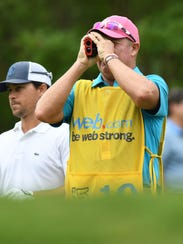 Casey Wittenberg, left, looks on as his caddy checks the yardage from the first tee during the third round of the 2017 BMW Charity Pro-Am at Greer's Thornblade Club.