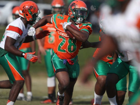 FAMU's Ricky Henrilus runs with the ball during the second day of their spring practice at the university on Friday, March 23, 2018.