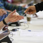 Wisconsin voters must now show ID at the polls.