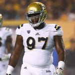 Incarcerated dad maintains role in life of Packers pick Kenny Clark