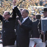 President Lyndon B. Johnson joins hands with Wisconsin Gov. John Reynolds in triumph during his campaign appearance in Milwaukee's Kosciuzsko Park on Oct. 30, 1964.